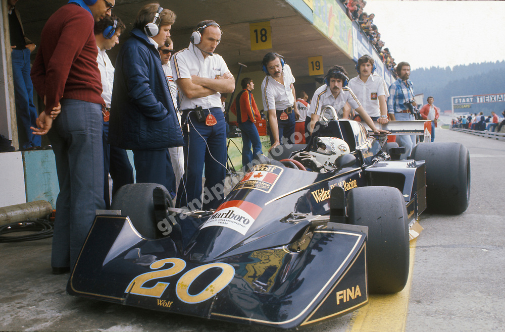Arturo Merzario in the Wolf Williams-Ford pits during practice for the 1976 Austrian Grand Prix at the Osterreichring. He is talking the team principal Frank Williams and technical director Patrick Head. Photo: Grand Prix Photo