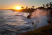 Surf batters the coast at sunset in Santa Cruz, California