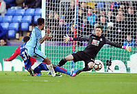Football - 2016 / 2017 FA Cup - Fourth Round: Crystal Palace vs. Manchester City<br /> <br /> Raheem Sterling of Man City scores his first half goal past Wayne Hennessey of Crystal palace at Selhurst Park.<br /> <br /> COLORSPORT/ANDREW COWIE