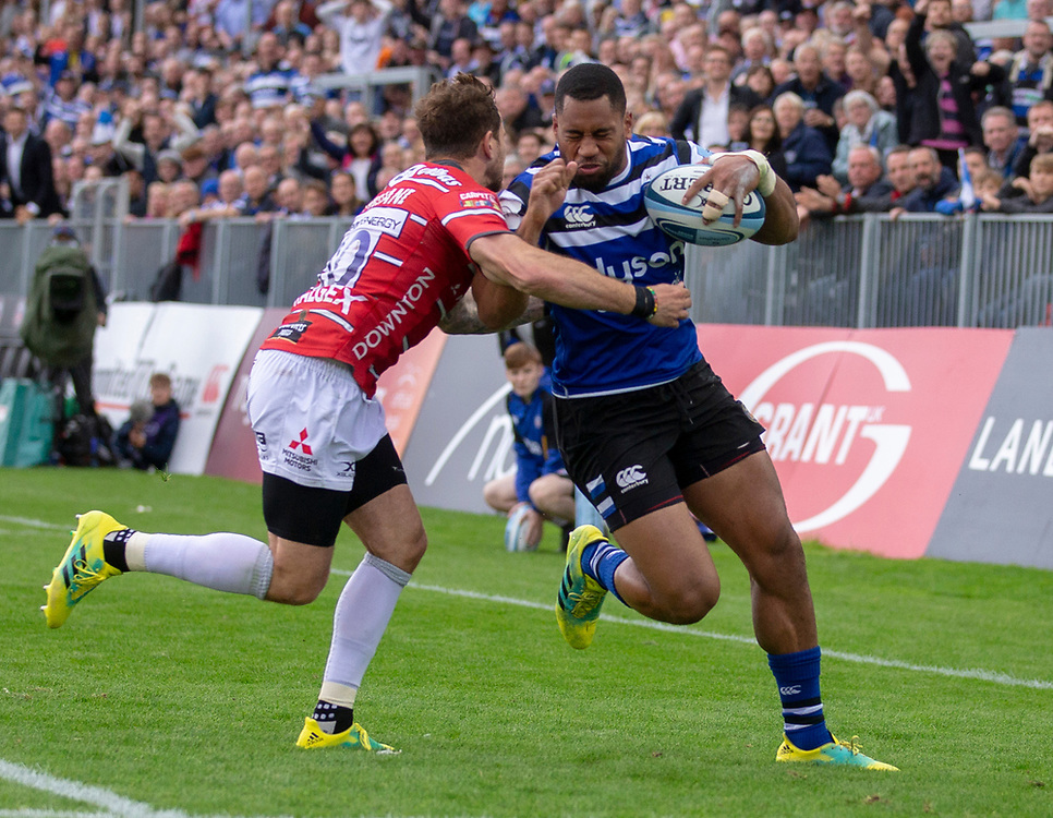 Bath Rugby's Joe Cokanasiga is tackled by Gloucester Rugby's Danny Cipriani<br /> <br /> Photographer Bob Bradford/CameraSport<br /> <br /> Gallagher Premiership - Bath Rugby v Gloucester Rugby - Saturday September 8th 2018 - The Recreation Ground - Bath<br /> <br /> World Copyright © 2018 CameraSport. All rights reserved. 43 Linden Ave. Countesthorpe. Leicester. England. LE8 5PG - Tel: +44 (0) 116 277 4147 - admin@camerasport.com - www.camerasport.com