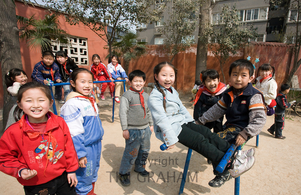Children in the playground of a primary school in Hong Ying Road, Xian. China has a one child policy to limit population.