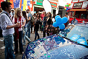 Car covered in well wishes. Street party on Battersea High Street to celebrate the Royal Wedding of Prince William and Kate Middleton, April 29th 2011. Thousands attended this one of the largest street parties in London. Embracing the diversity of the community, the theme of the party is world food, dance and music, with live coverage of the royal Wedding aired on a giant screen.