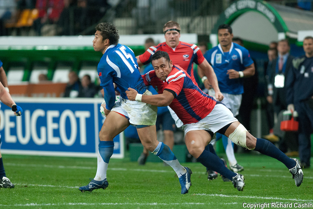 US winger Salesi Sika tackles Samoan full back Loki Crichtonthe during the 2007 Rugby World Cup pool game between Samoa and USA at Stade Geoffroy-Guichard in Saint-Étienne, France