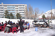 A carpark turns into a meeting point and BBQ at the base of Chimgan ski resort on 28th February 2014 in Uzbekistan. Chimgan is 90kms east of the capital Tashkent, and a popular weekend destination year round.