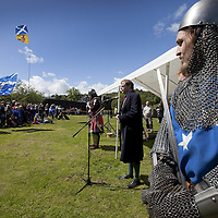 """The Earl of Moray, Andrew de Moray's direct descendent, speaks on the site of the Battle of Stirling Bridge.<br /> <br /> BRAVEHEART HEROES, WILLIAM WALLACE AND ANDREW DE MORAY, FINALLY HONOURED AT STIRLING BRIDGE BATTLE SITE AS SALTIRE RAISED FOR FIRST TIME IN OVER 700 YEARS<br /> <br /> Friday 29th May, 2015<br /> <br /> IT'S TAKEN more than 700 years but today, the two heroes at the centre of one of the most important battles in Scottish history have been jointly honoured at the spot where they both led an outnumbered Scottish army to victory against the English.<br /> The formal unveiling ceremony at Stirling Bridge today (Friday 29th May), of three lecterns made of traditional Scottish whinstone dedicated to the memory of William Wallace and Andrew de Moray,at site of the historic victory at Battle of Stirling Bridge.<br /> At a special ceremony attended by Andrew de Moray's direct descendant, the Earl of Moray, and Stewart Maxwell, MSP, convener of the Scottish Parliament's Education and Culture Committee, the memorials were formally unveiled.Mr Maxwell opened the event and after the dedication, together with the Earl of Moray, they raised the Saltire together at the site of the Battle of Stirling Bridge. This is the first time in over 700 years that the Saltire has flown at Stirling Bridge. The flag will now become a permanent fixture at the site of the Battle.<br /> John Stuart, the current Earl of Moray, said of his illustrious kinsman: """"I am delighted that Andrew de Moray is finally, after 700 years, to have the recognition he deserves. The Guardians of Scotland have put a huge amount of time and effort into the lecterns, which are a very fitting tribute to one of Scotland's greatest patriots.""""<br /> The victory represented a key moment in the Scottish Wars of Independence. Eminent Scots historian, Sir Tom Devine, recently described the battle as being 'second in importance only to Bannockburn in the Wars of Independence'.<br /> It is the first time the tw"""