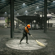 Visit of a coal refinery. Refined coal is the product of the application of a coal-upgrading technology that removes moisture and certain pollutants from lower-rank coals and raising their calorific values. Burning fossil fuels is the primary source of both climate-warming emissions and health-damaging air pollution.<br /> Mongolia