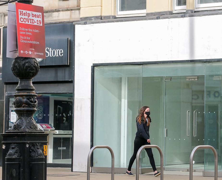 24th February, Cheltenham, England. A shopper walking through the town centre in Cheltenham during England's third national lockdown.