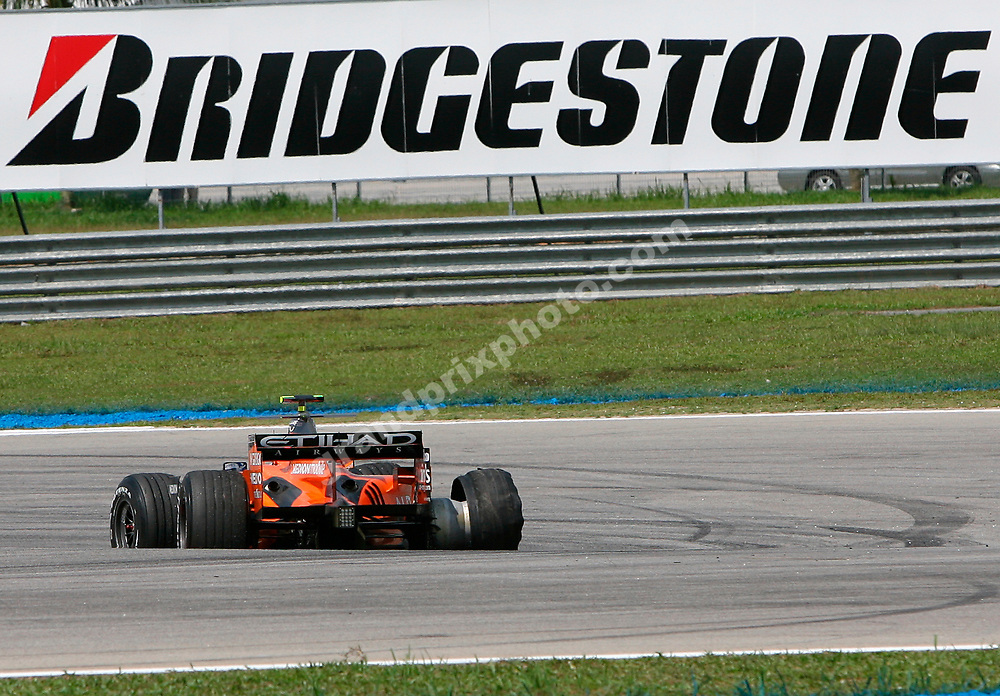 Christijan Allbers (Spyker-Ferrari) with a damaged Bridgestone tyre during practice for the 2007 Malaysian Grand Prix in Sepang. Photo: Grand Prix Photo