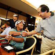 HONOLULU, HAWAII, November 7, 2007: Tadd Fujikawa, a sixteen-year-old professional golfer, is greeted by a fan at the Honolulu Country Club in Honolulu, Hawaii. (Photographs by Todd Bigelow/Aurora)