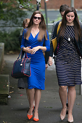 """© Licensed to London News Pictures. 14_07_2015. Solihull, West Midlands, UK. Pictured, BRYHER DUNSBY, widow of Cpl James Dunsby (blue dress, sunglasses). The inquest into the deaths of three army reservists taking place at Solihull Council House. Edward Maher, Craig Roberts and James Dunsby died after collapsing during an SAS training exercise on the Brecon Beacons in July 2013. The soldiers, from Hampshire, North Wales and Wiltshire, all suffered heatstroke during the 16-mile """"test week"""" march. Photo credit : Dave Warren/LNP"""