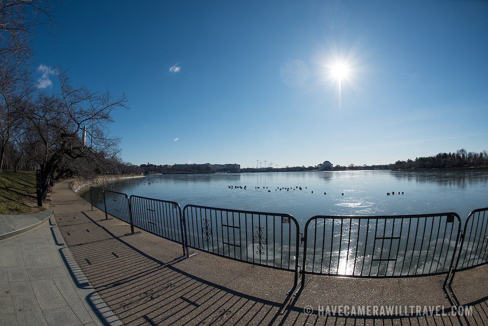 Washington DC's cherry blossoms and the area around the Tidal Basin on an especially cold morning on February 14, 2016. During an unusually cold snap in the winter, the Tidal Basin is frozen over under a clear blue sky.