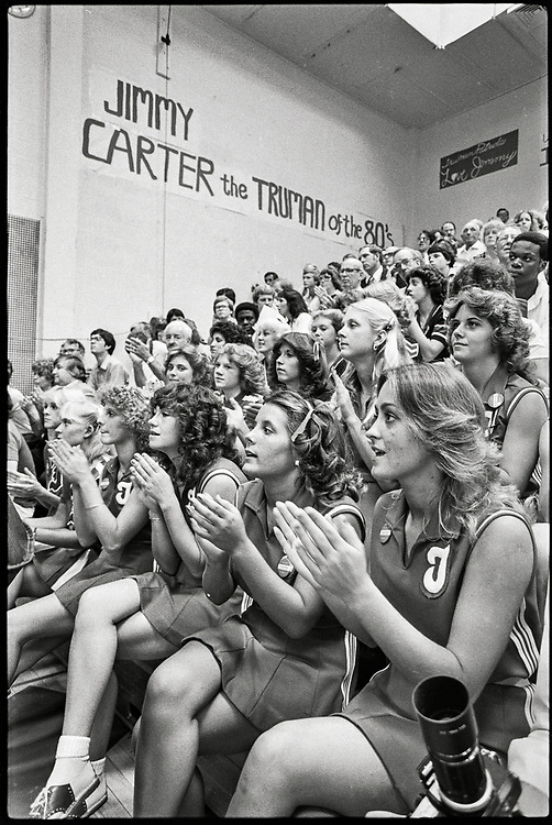 Cheerleaders applaud President Jimmy Carter at a Town Hall event in Independence, Missouri, September 2, 1980, during his re-election campaign.  Truman High School gynmasium.