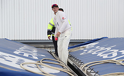 England captain Joe Root retrieves the ball from under the covers during day three of the First Investec Test match at Edgbaston, Birmingham.