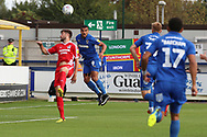 AFC Wimbledon striker Kweshi Appiah (9) winning header during the EFL Sky Bet League 1 match between AFC Wimbledon and Scunthorpe United at the Cherry Red Records Stadium, Kingston, England on 15 September 2018.