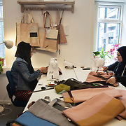 Women working in a local social enterprise on the estate, making designer bags for sale. Lundtoftegade is a housing estate in the heart of Copenhagen. The estate has been on the controversial Ghetto List for years but wastaken off 1st of December 2020. The Ghetto List is based on the Ghetto Law introduced by the Danish Govenrment in 2018. In 2020 a huge campaign was launched to raise 50.000 signatures demanding the Danish Parliament to reconsider the law and to abolish it. Part of the campaign was the national portrait poster campaign 'We ARE the mixed city'. More than 100 local residents in joined the campaign and were photographed in a small make shift studio set up in Lundtoftegade. These images are fragments of life in and around Lundtoftegade 2020.