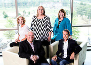 Darin Gray, president of CJRW, front left, Brian Rudisill, president of NWA market for CJRW, Maxine Williams, Denise Davis and Donna Williams, back left to right, on Monday, June 16, 2014, in Johnson, Ark.<br /> <br /> Photo by Beth Hall