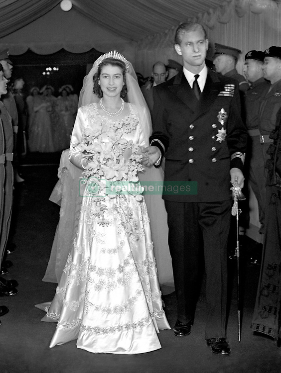 Queen Elizabeth II and her husband Prince Philip, Duke of Edinburgh, leave Westminster Abbey after the wedding ceremony