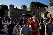 Tourists at the Tower of London. A big draw for tourism, this famous area and landmark brings in thousands of people every day.