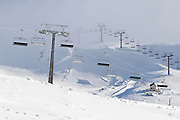 Two chairlifts sit idle at the end of a day at ski field Turoa. Turoa is located on active volcano Mount Ruapehu, New Zealand.