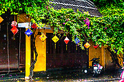 Oct.  2020, Hoi An: Old Town on a rainy day catching the rain drops in mid air. Saturated  colors  of UNEXCO of Hoi an famous yellow.