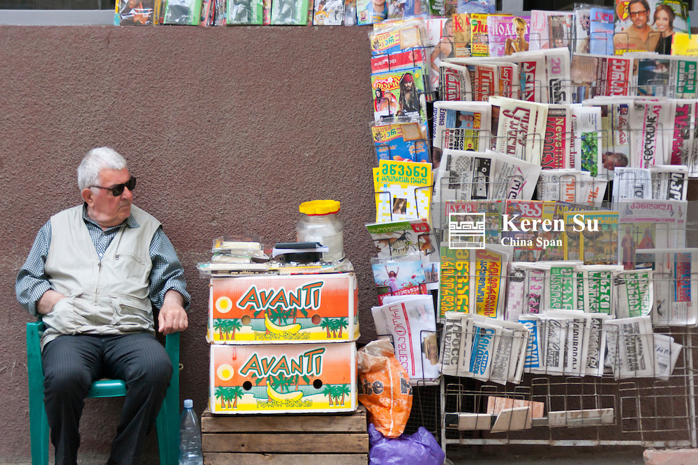 Selling magazines and newspapers, Tbilisi, Georgia