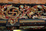 Hand carved portal, showing ancient Hindu symbol, the swastika. Sanur, Bali, Indonesia