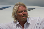 Alongside his SpaceShipTwo vehicle, Richard Branson after Virgin Galactic space tourism presentation at Farnborough