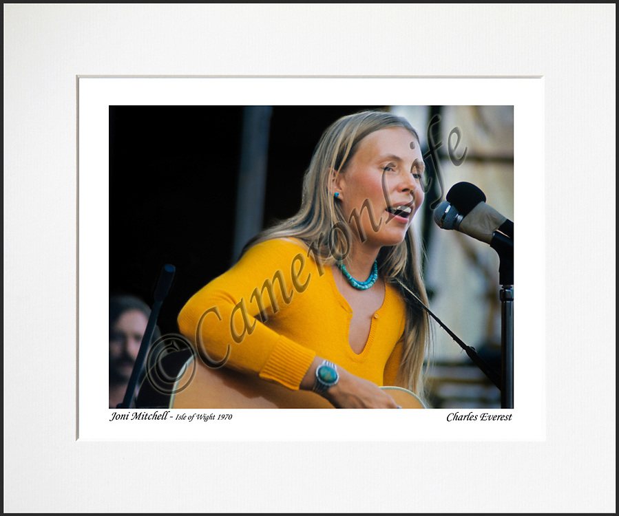 """Joni Mitchell- An affordable archival quality matted print ready for framing at home.<br />  Ideal as a gift or for collectors to cherish, printed on Fuji Crystal Archive photographic paper set in a neutral mat (all mounting materials are acid free conservation grade). <br />  The image (approx 6""""x8"""") sits within a titled border. The outer dimensions of the mat are approx 10""""x12"""""""