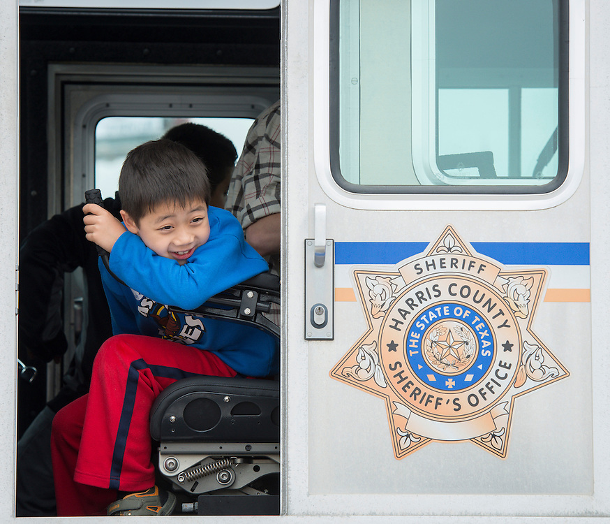 A young student checks out the Harris County Sheriff's Department boat at the When I Grow Up fair, March 8, 2014.