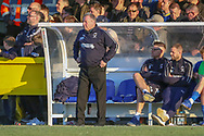 AFC Wimbledon manager Wally Downes stood in dug out during the EFL Sky Bet League 1 match between AFC Wimbledon and Charlton Athletic at the Cherry Red Records Stadium, Kingston, England on 23 February 2019.