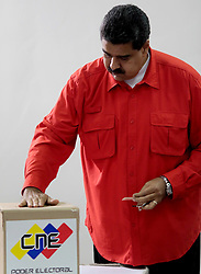 July 30, 2017 - Caracas, Venezuela - Venezuelan President NICOLAS MADURO casts his vote during the election for the National Constituent Assembly (ANC), in Caracas. All the polling stations for electing members to the National Constituent Assembly in Venezuela opened, despite opposition-led protests against the election. (Credit Image: © Venezuela'S Presidency/Xinhua via ZUMA Wire)