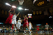 WACO, TX - DECEMBER 18: Tia Faleru #32 of the Mississippi Lady Rebels has her shot blocked by Sune Agbuke #22 the Baylor Bears on December 18 at the Ferrell Center in Waco, Texas.  (Photo by Cooper Neill) *** Local Caption *** Tia Faleru; Sune Agbuke