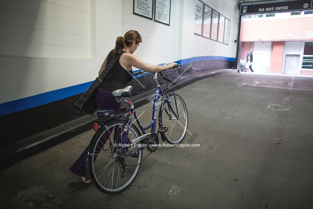 Penelope Crabtree who lives in Tribecca Towers uses a new private bike share program that Related Real Estate is launching at ten of its properties in NYC. Each property has between 2-4 bikes, operated by Zagster (a bike share company), that are available to residents of the building. It's the latest in a long line of amenities designed to make rentals more appealing. <br /> <br /> (Photo by Robert Caplin)