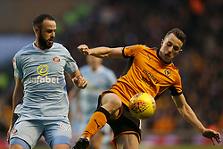 """Wolverhampton Wanderers' Diogo Teixeira da Silva and Sunderland's Marc Wilson during the Sky Bet Championship match at Molineux, Wolverhampton. PRESS ASSOCIATION Photo. Picture date: Saturday December 9, 2017. See PA story SOCCER Wolves. Photo credit should read: Barrington Coombs/PA Wire. RESTRICTIONS: EDITORIAL USE ONLY No use with unauthorised audio, video, data, fixture lists, club/league logos or """"live"""" services. Online in-match use limited to 75 images, no video emulation. No use in betting, games or single club/league/player publications."""