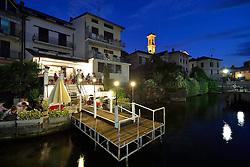 THEMENBILD - Die Lombardei ist eine norditalienische Region mit einer Fläche von 23.863 km und ca.9,8 Mio. Einwohnern. Sie ist in zwölf Provinzen aufgeteilt und liegt zwischen Lago Maggiore, Po und Gardasee. Bilder aufgenommen am 21. August 2013, im Bild Nachtaufnahme Restaurant da Claudia und Uferpromenade mit Pfarrkirche Chiesa Sancto Ambrosio, Hafenstaedtchen am Luganersee, Lago di Lugano, Porto Ceresio // THEMES PICTURE - Lombardy is a northern Italian region with an area of 23,863 km and a population of 9,8 Mio. It is divided twelve provinces and is situated between Lake Maggiore, Lake Garda and Po. Pictured on 2013/08/21. EXPA Pictures © 2013, PhotoCredit: EXPA/ Eibner/ Michael Weber<br /> <br /> ***** ATTENTION - OUT OF GER *****