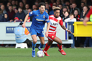 AFC Wimbledon defender Will Nightingale (5) battles for possession with Doncaster Rovers attacker Mallik Wilks (7) during the EFL Sky Bet League 1 match between AFC Wimbledon and Doncaster Rovers at the Cherry Red Records Stadium, Kingston, England on 9 March 2019.