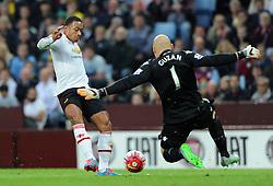 Memphis Depay of Manchester United is closed down by Brad Guzan of Aston Villa - Mandatory byline: Dougie Allward/JMP - 07966386802 - 14/08/2015 - FOOTBALL - Villa Park -Birmingham,England - Aston Villa v Manchester United - Barclays Premier League