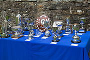 The Hardraw Scaur Brass Band Festival trophies. Organised by the Yorkshire and Humberside Brass Band Association, the competition is Britain's second oldest outdoor contest and takes place annually in Hardraw Scar in Wensleydale, North Yorkshire, England, UK. The area, a natural amphitheatre, attracts bands from all over the North of England and is a popular event amongst players and audiences alike.