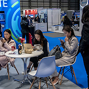 Chinese ladies Wechat with the mobiles at London Tech Week at Excel London,on 12 June 2019, UK