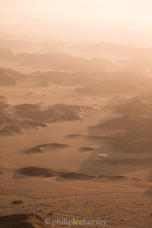 Aerial view of light aircraft flying over mountains, Skeleton Coast, hoanib river, Northern Namibia, Southern Africa
