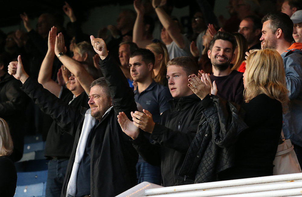 Gillingham fans celebrate at the final whistle<br /> <br /> Photographer David Shipman/CameraSport<br /> <br /> The EFL Sky Bet League One - Peterborough United v Gillingham - Saturday 14th October 2017 - London Road Stadium - Peterborough<br /> <br /> World Copyright © 2017 CameraSport. All rights reserved. 43 Linden Ave. Countesthorpe. Leicester. England. LE8 5PG - Tel: +44 (0) 116 277 4147 - admin@camerasport.com - www.camerasport.com