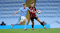 Football - 2020 / 2021 EFL Carabao Cup - Round Three - Manchester City vs AFC Bournemouth<br /> <br /> Tommy Doyle of Manchester City and David Brookes of Bournemouth at the Etihad Stadium.<br /> <br /> COLORSPORT/LYNNE CAMERON
