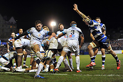 Jonathan Pelissie of Montpellier box-kicks the ball as Dominic Day of Bath Rugby looks to charge him down - Photo mandatory by-line: Patrick Khachfe/JMP - Mobile: 07966 386802 12/12/2014 - SPORT - RUGBY UNION - Bath - The Recreation Ground - Bath Rugby v Montpellier - European Rugby Champions Cup
