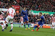 Gary Cahill of Chelsea (r) shoots and scores his teams 2nd goal. Premier league match, Stoke City v Chelsea at the Bet365 Stadium in Stoke on Trent, Staffs on Saturday 18th March 2017.<br /> pic by Andrew Orchard, Andrew Orchard sports photography.