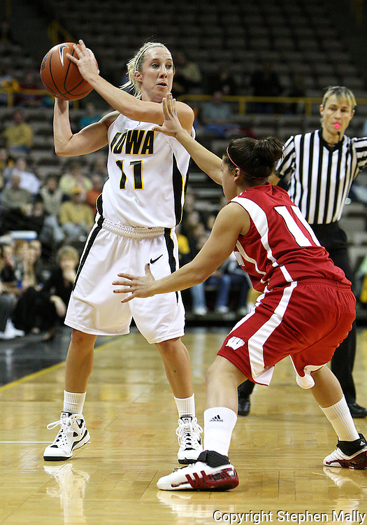 19 February 2009: Iowa guard Kristi Smith (11) is defended by Wisconsin guard Rae Lin D'Alie (11) during the first half of an NCAA women's college basketball game Thursday, February 19, 2009, at Carver-Hawkeye Arena in Iowa City, Iowa. Iowa defeated Wisconsin 72-65.