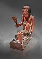 Ancient Egyptian wooden model of a man cooking a duck, Middle Kingdom, 11-13th Dynasty, (1980-1700 BC), Asyut. Egyptian Museum, Turin. Cat 8944. Grey background. <br /> <br /> Wooden tomb models were an Egyptian funerary custom throughout the Middle Kingdom in which wooden figurines and sets were constructed to be placed in the tombs of Egyptian royalty. These wooden models represented the work of servants, farmers, other skilled craftsman, armies, and religious rituals .<br /> <br /> If you prefer to buy from our ALAMY PHOTO LIBRARY  Collection visit : https://www.alamy.com/portfolio/paul-williams-funkystock/ancient-egyptian-art-artefacts.html  . Type -   Turin   - into the LOWER SEARCH WITHIN GALLERY box. Refine search by adding background colour, subject etc<br /> <br /> Visit our ANCIENT WORLD PHOTO COLLECTIONS for more photos to download or buy as wall art prints https://funkystock.photoshelter.com/gallery-collection/Ancient-World-Art-Antiquities-Historic-Sites-Pictures-Images-of/C00006u26yqSkDOM