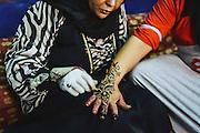Henna artist working on Heba's hand in Seheil Island