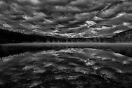 Morning mist sensuously caresses dreamy Patricia Lake and awakens her with whispers of sweet nothings. Seas of clouds converge over the Rockies and bear witness to the morning romance that is amplified by pure reflection.