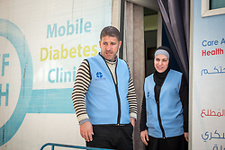 26 February 2020, Abu Dis, Palestine: Supervisor Ziad Paradiah (left) and nurse Najwa Hawamdeh (right) work at the Mobile Diabetes Clinic of the Augusta Victoria Hospital. In an effort to make Diabetes services more accessible to people in the West Bank, the Augusta Victoria Hospital offers a Mobile Diabetes Clinic, which moves around to various locations in the West Bank, offering screening and routine testing for Diabietes and the symptoms it causes.