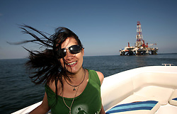 05 May 2010. Venice, Louisiana. Deepwater Horizon, British Petroleum environmental oil spill disaster.<br /> ARCA NASCAR rising motor racing star and environmental activist Leilani Munter takes a trip into the Gulf to see the disaster for herself.<br /> Here she passes the 'Ocean Saratoga' drilling platform, where drilling continues as oil companies strive to build ever more oil rigs in the Gulf. Photo credit; Charlie Varley/varleypix.com
